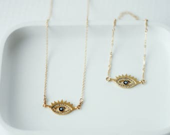 Collier 16'' doublé or avec œil protecteur sertie de zircons