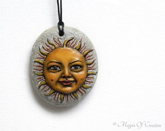 Sun face sculpture on stone pendant, hand sculpted hand painted smiling sun on stone as a unique art necklace for sun lovers!