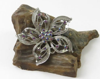Vintage Costume Flower Brooch with Rhinestone Accents and Silver Tone Finish