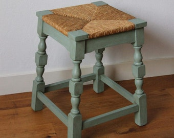 Vintage wooden stool with wicker reed seat ; pimped in blue shabby chic style