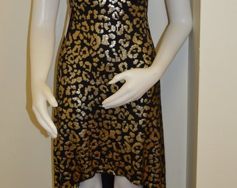 Black and gold sequin leopard hi-lo dress with embellished bra top.  Stretch knit dress with handkerchief back, sequin trim and rhinestones