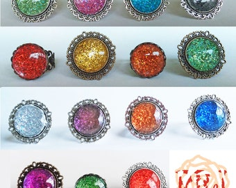 Bright holographic/glitter cabochon rings.FrancescaRoseJ.Only one available of each, choose which one you would like from the dropdown menu.