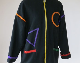 Fantastic women's Anage, black wool coat with brightly colored geometric appliqué, made in India. Size Small/ Medium