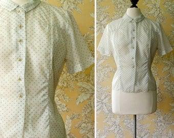 vintage 1950s blouse <> 1950s nylon blouse <> sheer nylon blouse with rosebud print <> 50s button front short sleeve blouse
