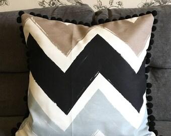 Cushion - multicoloured zigzag print with pompom trim