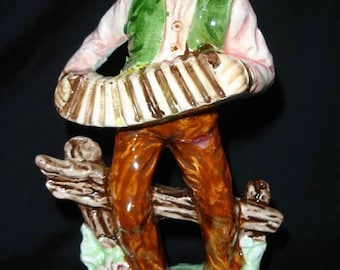 Porcelain figurine, standing man playing the accordion and singing. Height: 7 3/4 in. (Japan, c.1950).