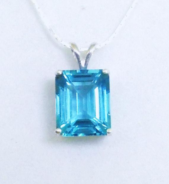 Swiss blue topaz birthstone pendant necklace 5 carat gemstone like this item mozeypictures Images