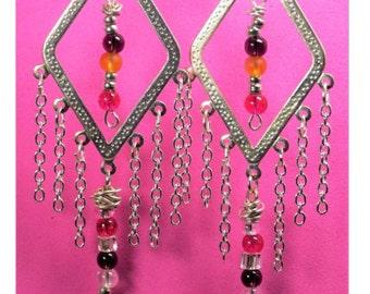 Fling wing drape earrings