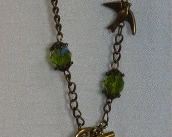 Sparrow, brass and Czech green olivine glass bead lariat necklace