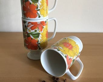 Darling trio of vintage Goodwood Japan white ceramic pedestal coffee / tea mugs with orange & yellow tropical Old Florida flowers!