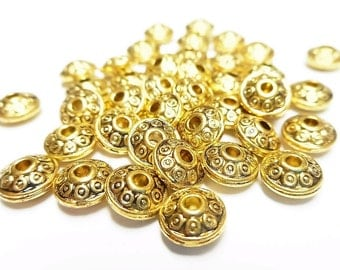50 beads interlayer color gold aged 7 * 5 mm
