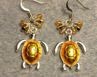 Bright topaz enamel turtle dangle earrings adorned with tiny dangling topaz Czech glass beads.