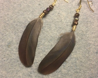 Bronze and purple Pionus parrot feather earrings adorned with small brown and purple Czech glass beads.