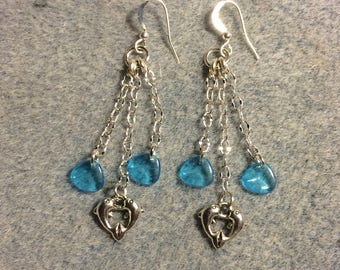 Silver dolphin charm dangle earrings attached to silver chain and adorned with small turquoise Czech glass rose petal beads.