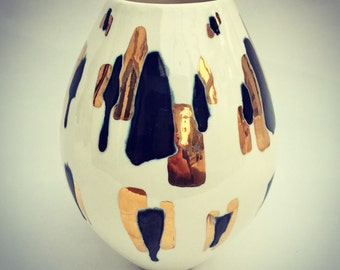 Ceramic pot with glazes and gold lustre.
