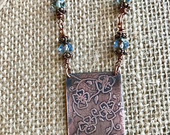 Floral etched copper pendant with Czech glass beads