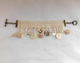 Cream Knitted Bracelet with Dangling Buttons