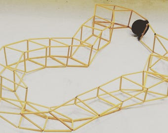 3D effect necklace with yellow glass rods and push button design/architecture///collana necklace