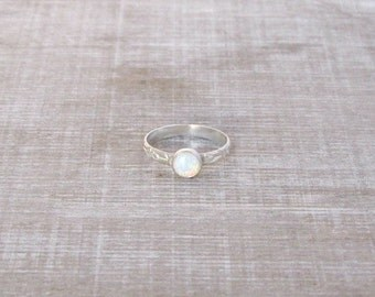 Opal ring,  6mm opal with starling silver oriental looks band.