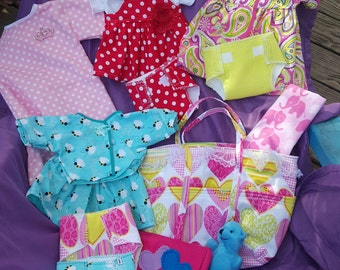 Baby doll diaper bag with clothes