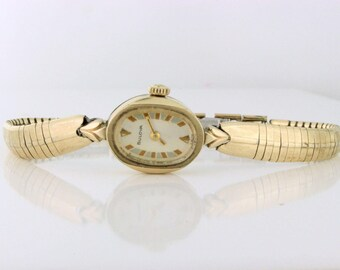 Fun Vintage Bulova Watch! 17 Jewels with orange and teal accent on the face. 10k RGP