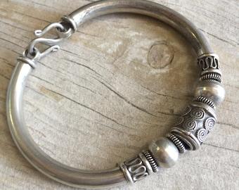 Chunky silver bracelet with a unique design.chunky silver bracelet, silver bracelet, silver beaded bracelet