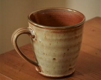 Pottery Coffee Mug, Tea or Hot Cocoa Mug by Fire Garden Pottery. 10 oz pottery mug. Shino with matte cream-orange glaze.