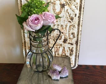 Glass and metal pitcher