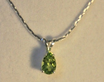 A Lovely faceted Peridot pendant  7X5 mm