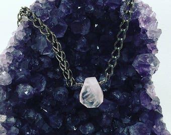 Rose quartz on gunmetal