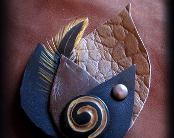 With leather and feather hair Barrette