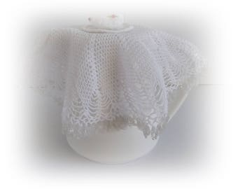 Vintage white crochet jug cover with beading and cup and saucer