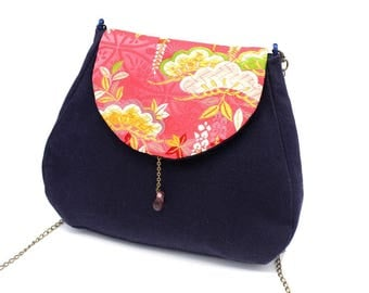 Navy blue messenger bag enhanced with pink Japanese fabric