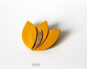Lotus petals ochre gold leather pin