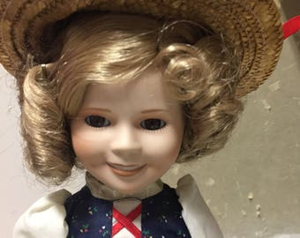 Danbury Mint Shirley Temple Heidi Doll stands 14 inches tall