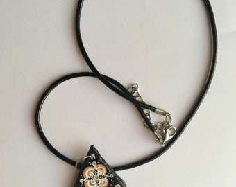 Handmade black triangle necklace with patterned detail