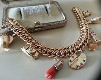 Exceptional vintage charm bracelet GOLD 18 K