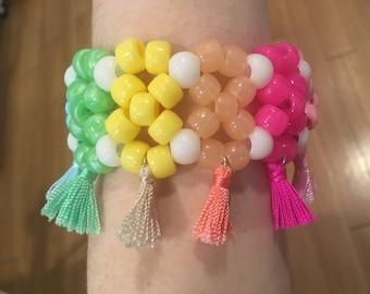 Rainbow tassel kandi cuff bracelet