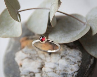 Silver ring with garnet stone