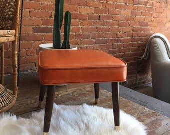 mid century orange embossed footstool