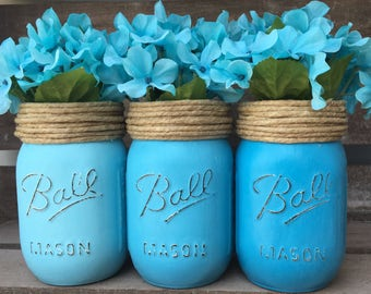 Blue teal hombre mason jars with twine and blue flowers