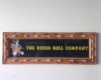 The Rodeo Bull Company reclaimed sign in reclaimed wood frame very WESTERN
