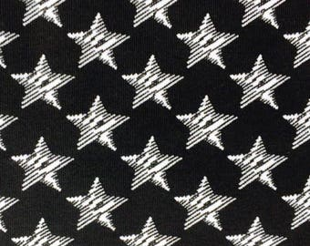 KNIT: Black Stars Knit Fabric. Sold by the 1/2 Yard