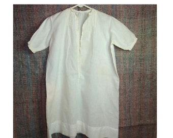 Vintage baby gown with pretty hand worked embroidered and pleated front, puffy short sleeves. No tag. See description below for measurements