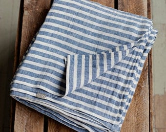 Stone washed flat linen sheet, pinstriped in off white and navy blue colours. Twin, double, queen, king sizes.