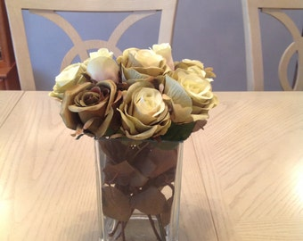 Two Tone Sage Green Roses in Bloom and Bud. Arranged in a solid tall rectangle Glass Vase.