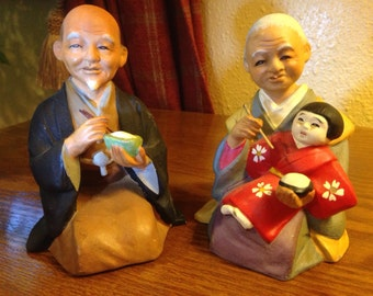 Vintage Ceramic Chinese Couple with Child Eating Rice