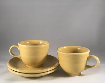 Two Vintage Fiestaware Yellow Tea Cups and Saucers Homer Laughlin Co