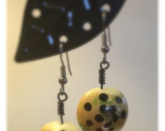 Hand wire-wrapped flower bead dangle.