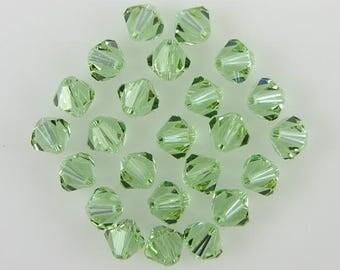 24 6mm Swarovski crystal bicone 5301 Cantaloupe beads 3869